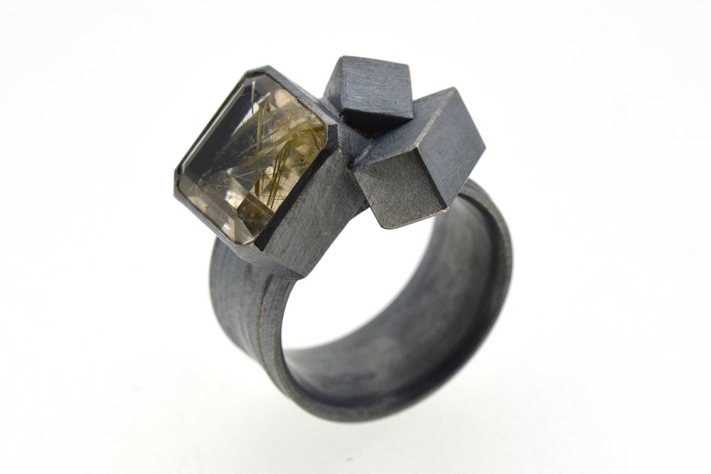 Image of Silver Strata ring with 12mm emerald cut rutilated quartz, set in oxidized silver with cubes