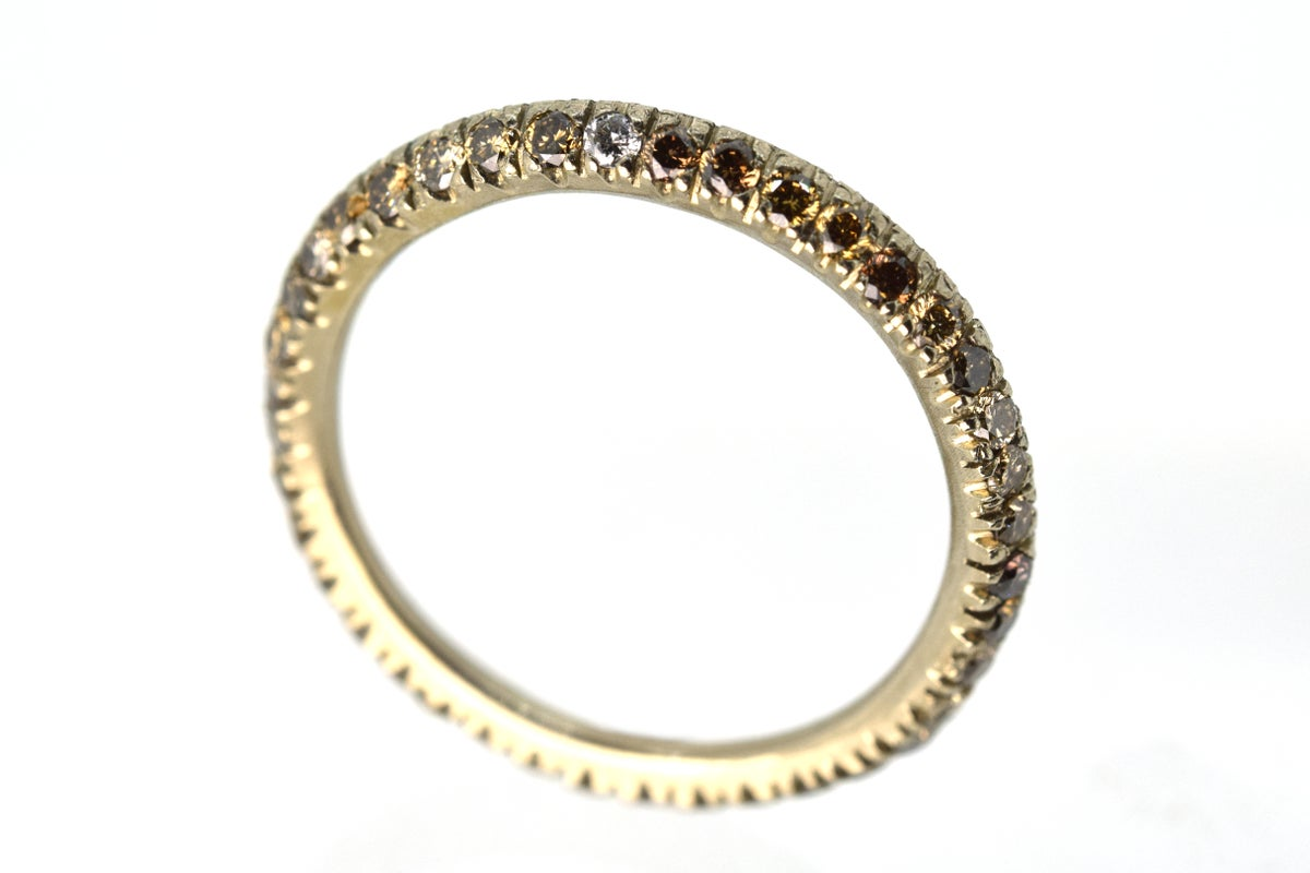 Full eternity ring. 0.7ct of mixed conyac coloured diamonds