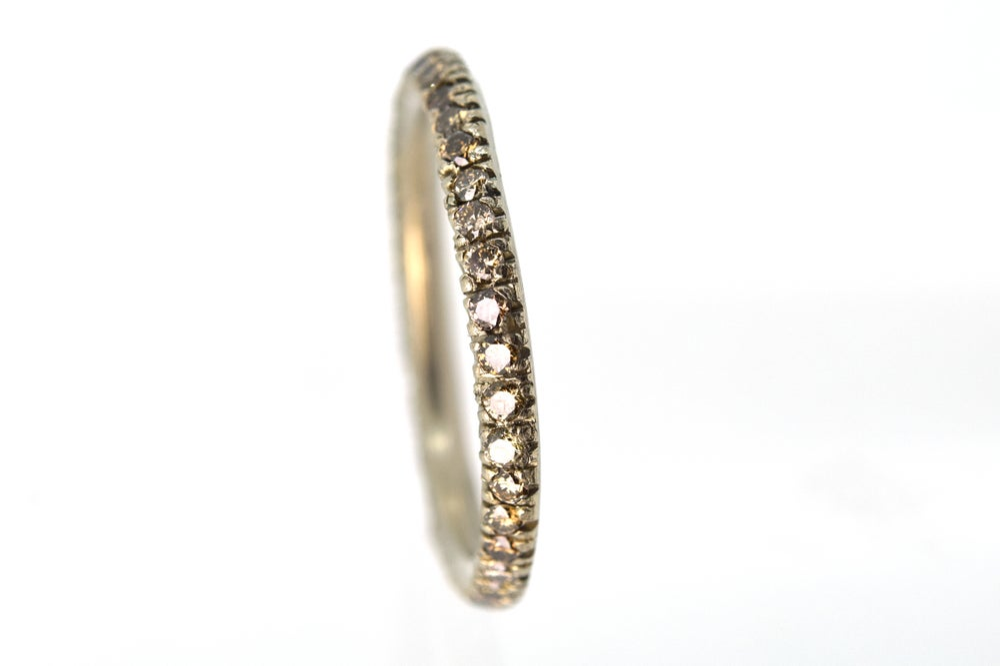 Image of Full eternity ring. 0.7ct of mixed conyac coloured diamonds