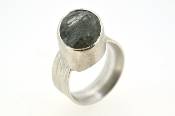 Image of Silver Strata ring with oval aquamarine with goethite inclusions
