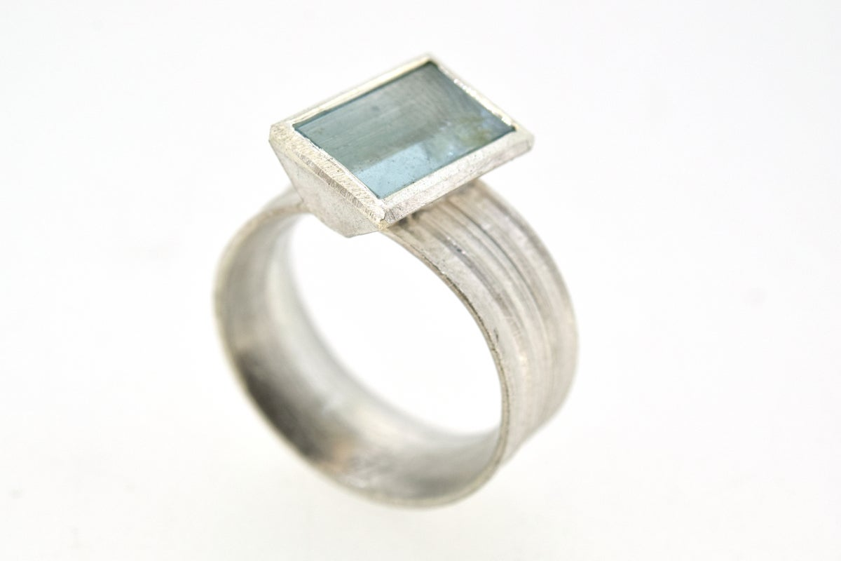 Silver Strata ring with mirror cut aquamarine
