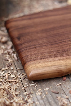 Image of Long charcuterie or cheese serving board, live edge wooden serving board