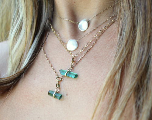 Image of Balance necklace. Green tourmaline set in 9ct gold.