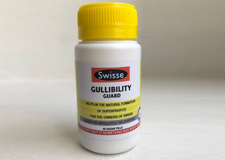 Image of Swisse 'Gullibility Guard' with FREE bottle of 'Help you choose between all the fucking vitamins'