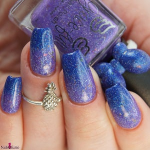 Image of Evil Twin – a thermal that moves from dark blue to purple with ultra chrome flakes and holo flakes