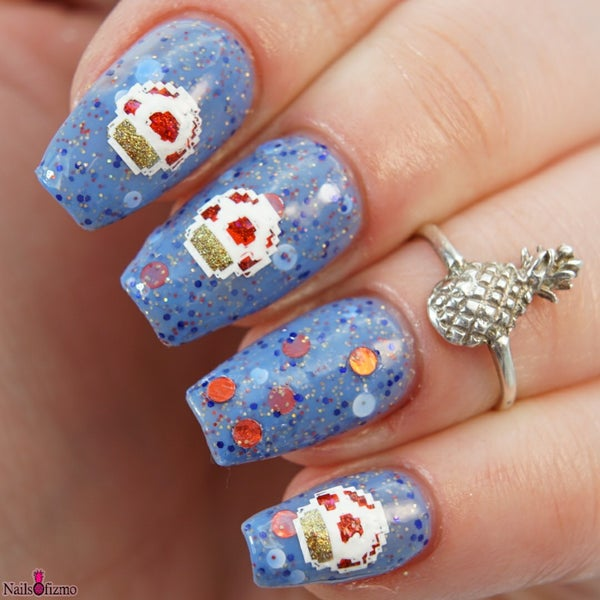 Image of Captain Toad –blue base, dot glitter in red holo & matte white, with blue, red & gold hex gl