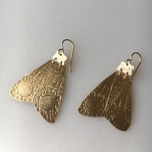 Image of brass moth earring