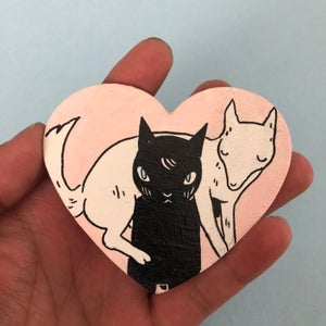 Image of Cat Carrying Wolf Valentine