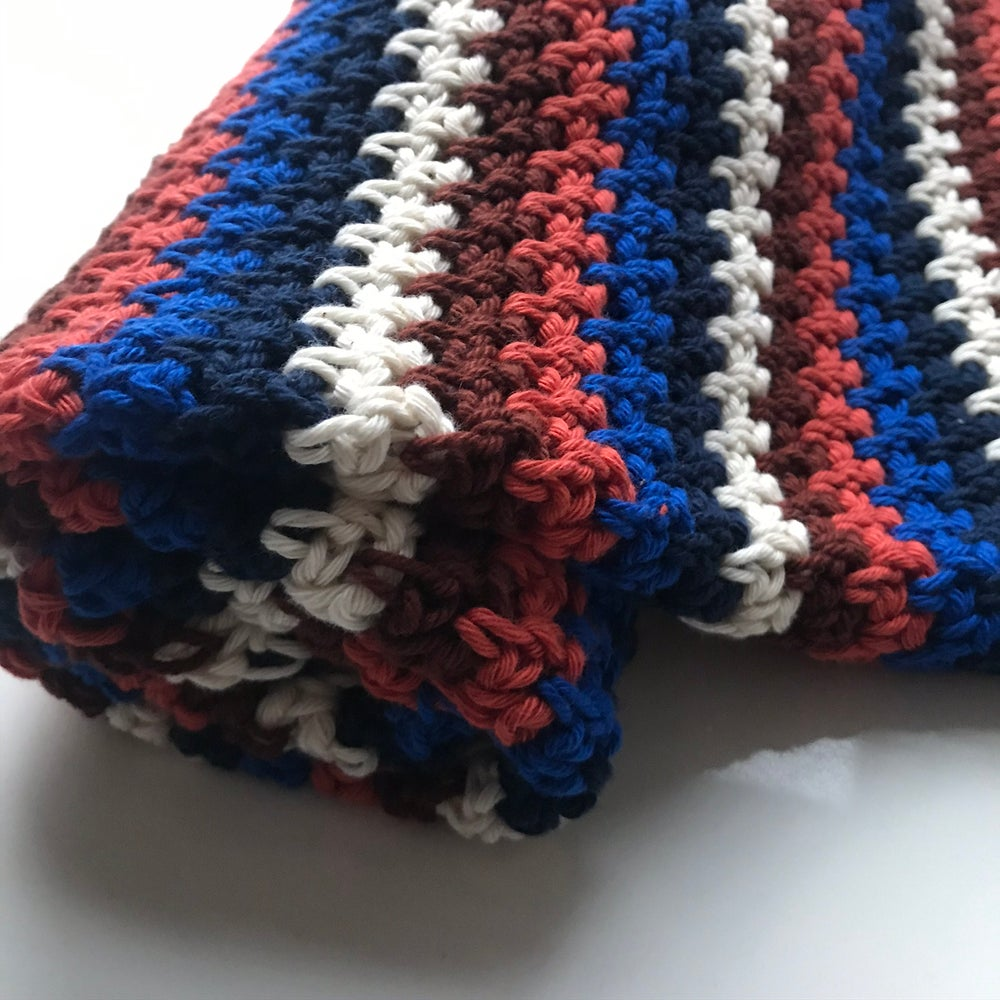 Image of RETRO INSPIRED CROCHET BABY BLANKET IN BLUES + BROWN