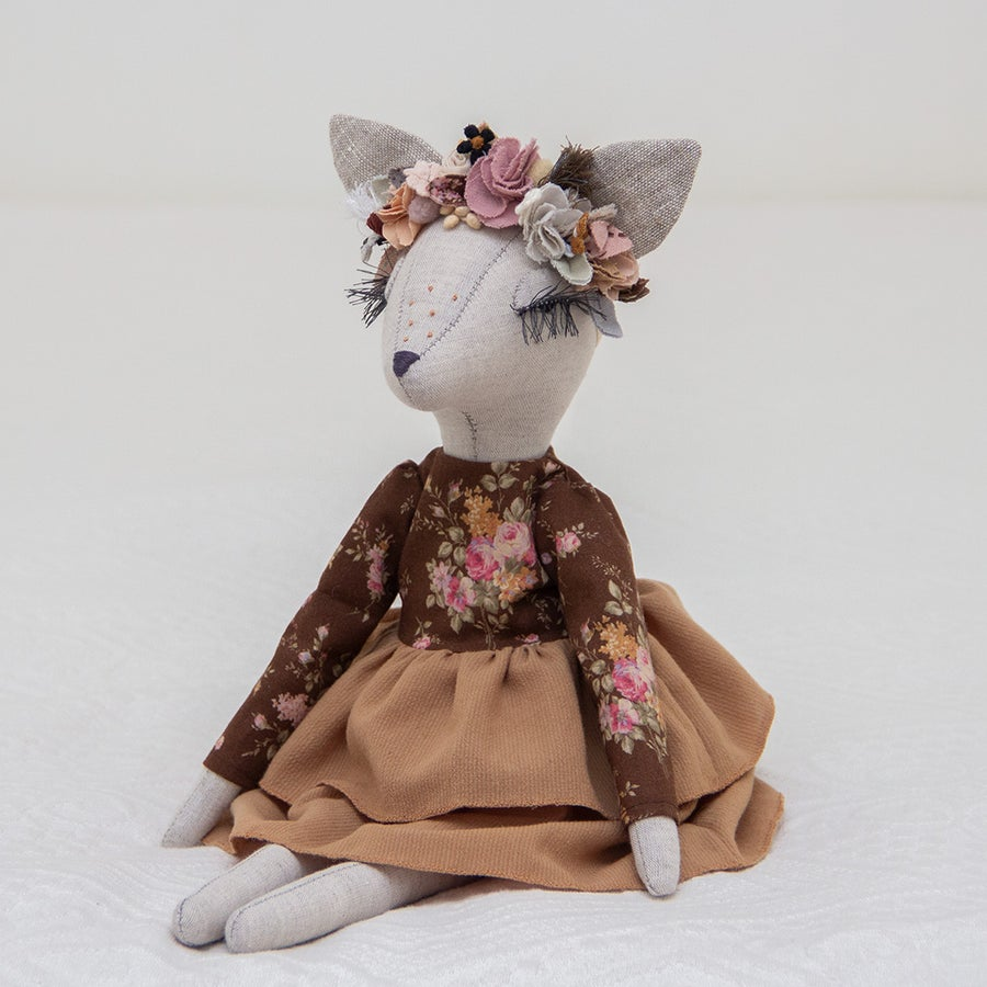 Image of Boho Deer heirloom doll with a brown floral dress