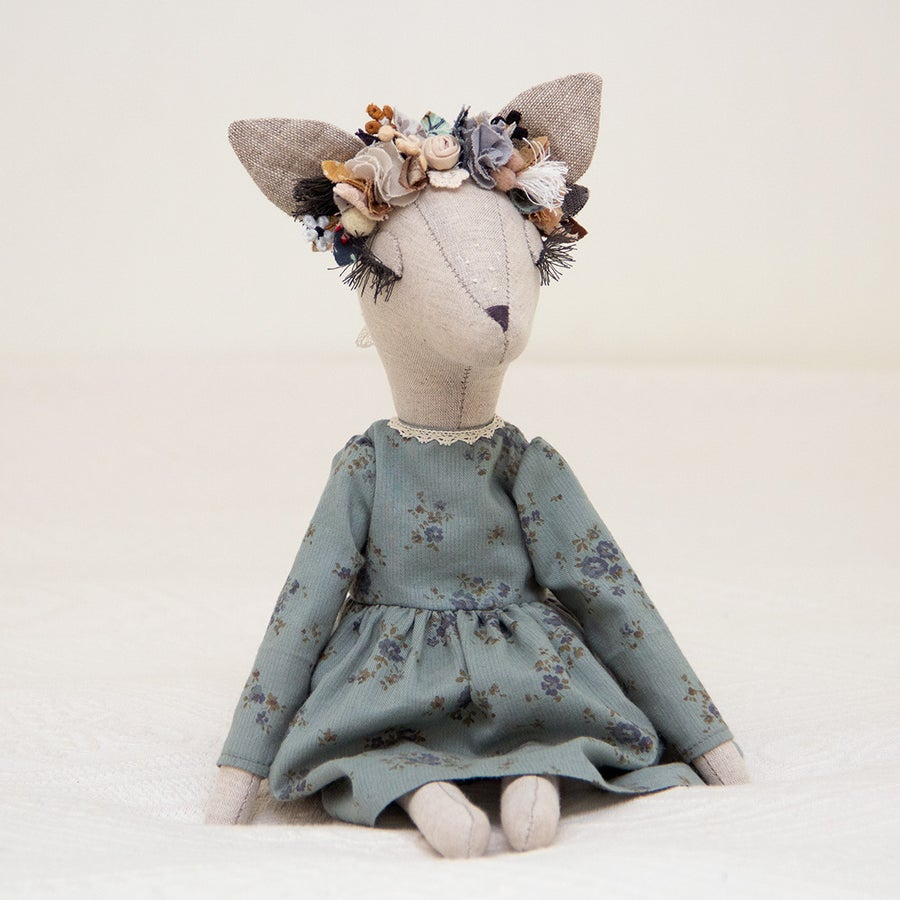Image of Boho Deer heirloom doll with a teal floral dress