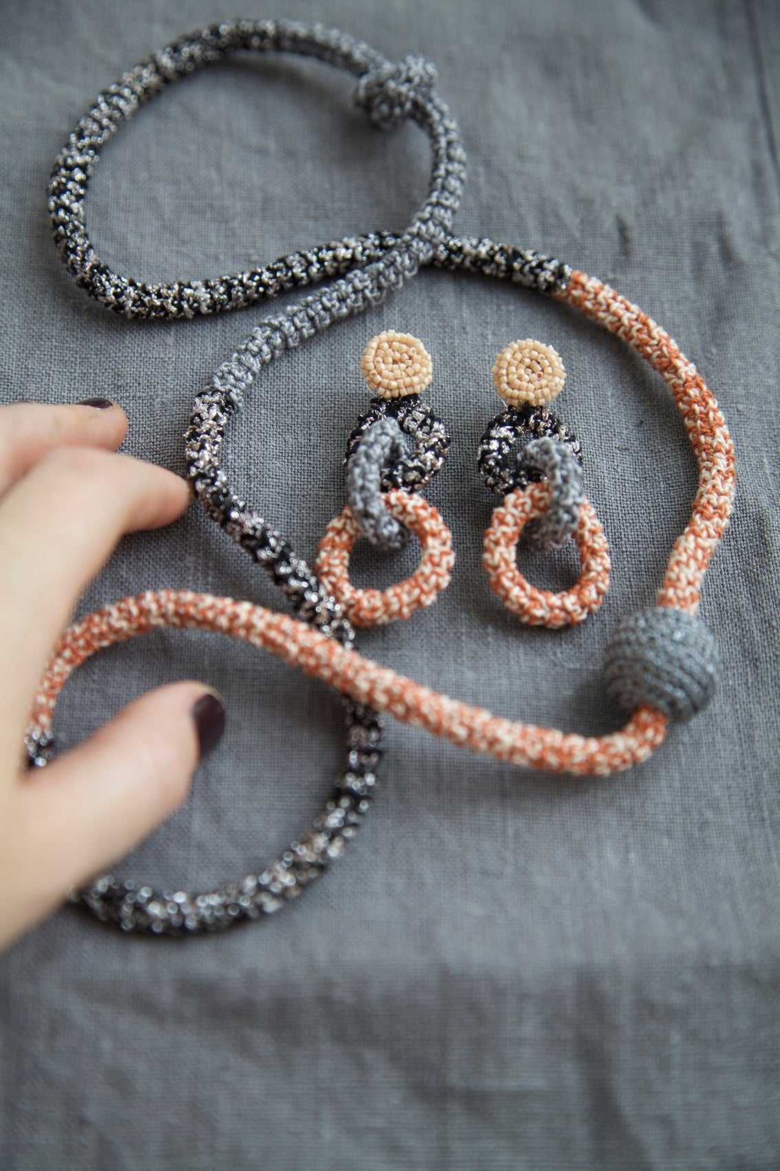Image of Coal and Terracotta Snake necklace