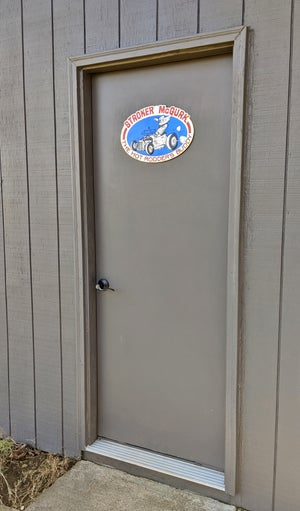 Back in Stock! Stroker McGurk Tin Garage Sign