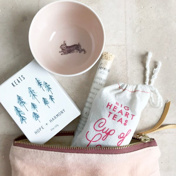 Image of winter survival kit: naturally-dyed pouch, soap, porcelain bowl, tea, bath salts