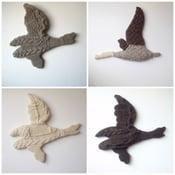 Image of custom hand knit ducks