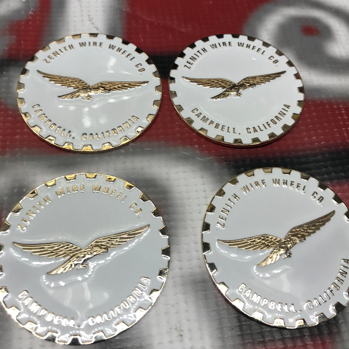 Image of Zenith Wire wheels  2.25 Emblems White/Gold