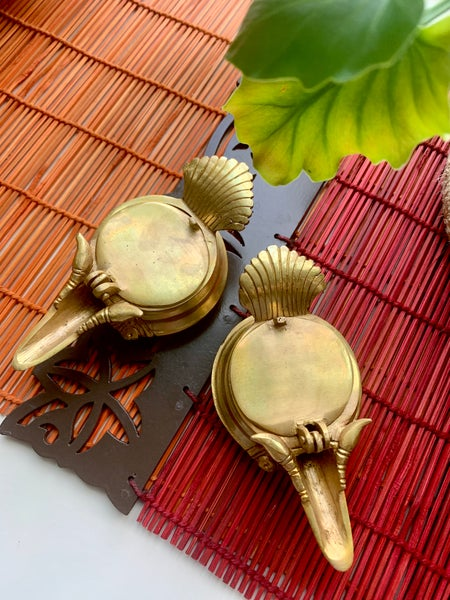 Image of A pair of unique brass diyas