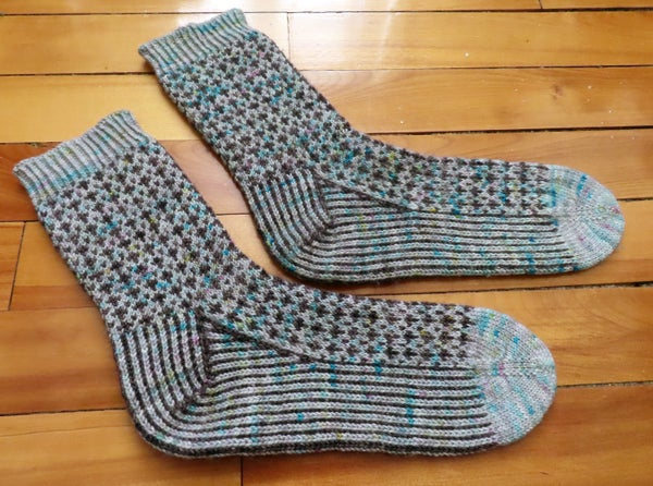 Image of handknit colorwork cross socks