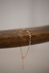 Image of ROSE GOLD BRACELET WITH A SERIES OF BLACK RAW DIAMONDS