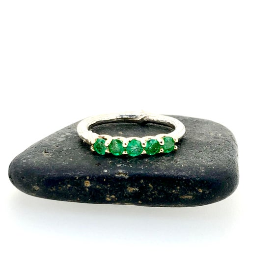 Image of five emerald wedding band
