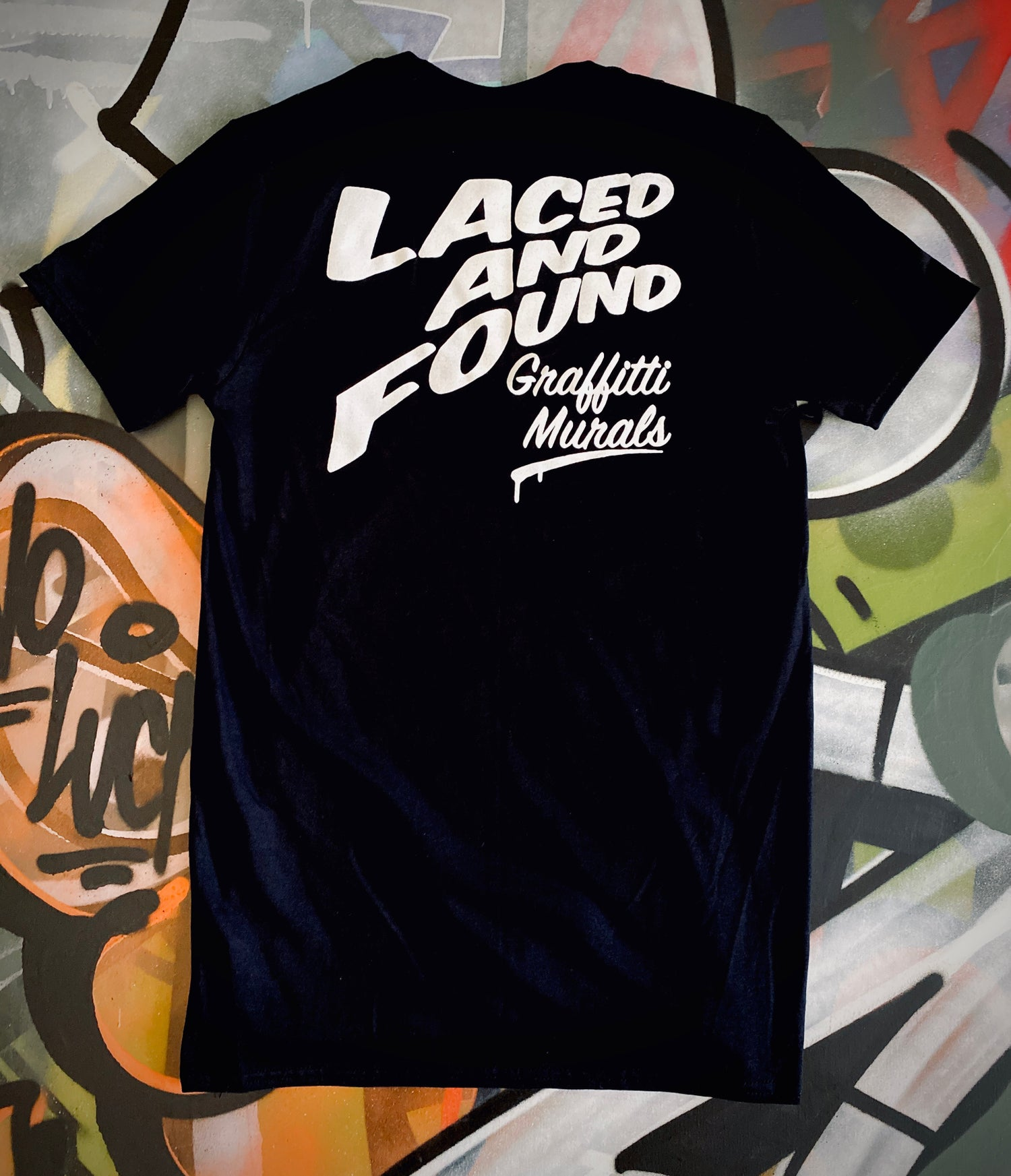 Image of LACED AND FOUND SIGN MURALS TEE
