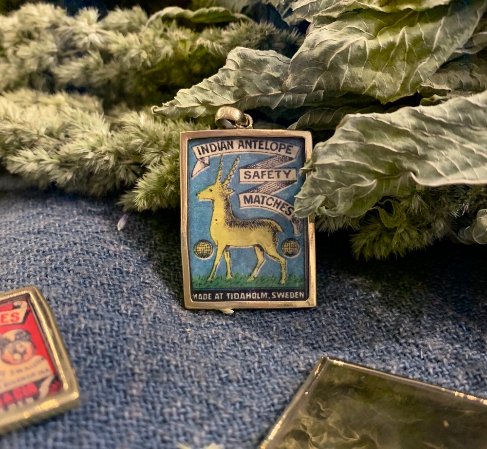 Image of Vintage Matchbox Blue 'Indian Antelope' Pendant