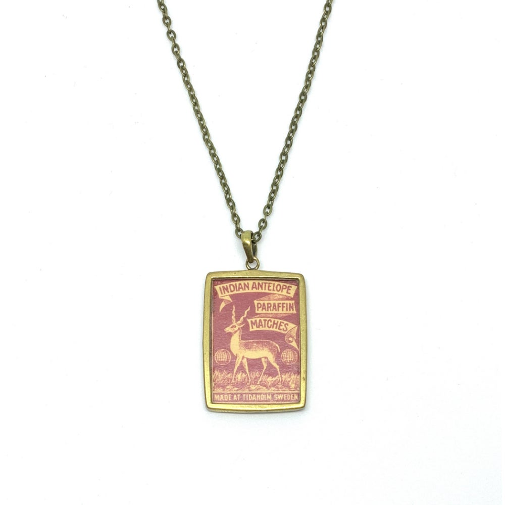 Image of Vintage Matchbox Red 'Indian Antelope' Pendant