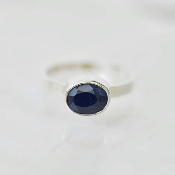 Image of Light Blue Sapphire oval cut silver ring