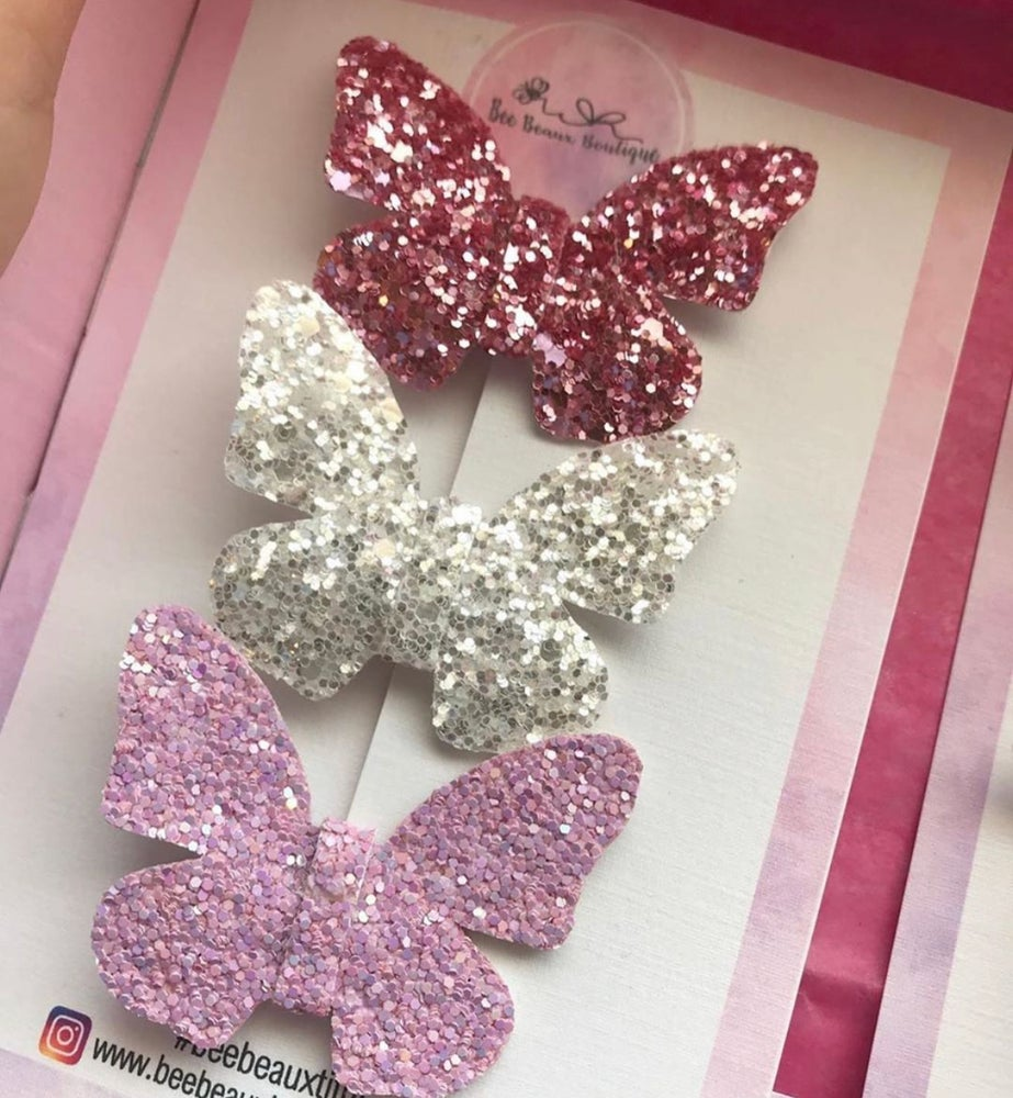 Image of Butterfly clips