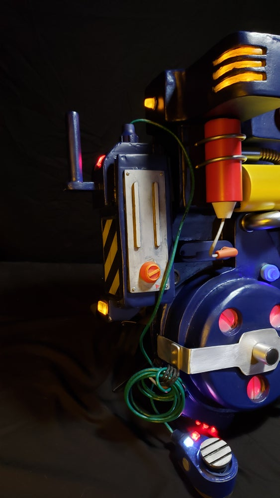 Image of RGB cartoon style proton pack and ghost trap