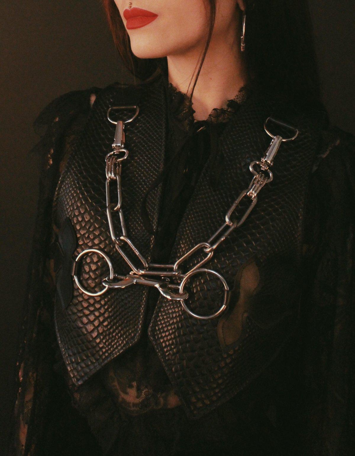 Vegan snakeskin waistcoat silver details