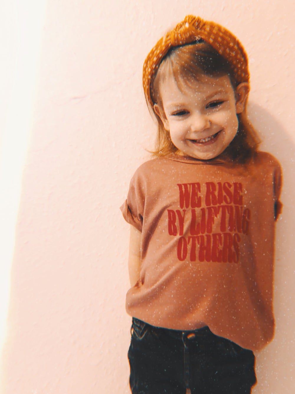 Image of We rise by lifting others kids tee