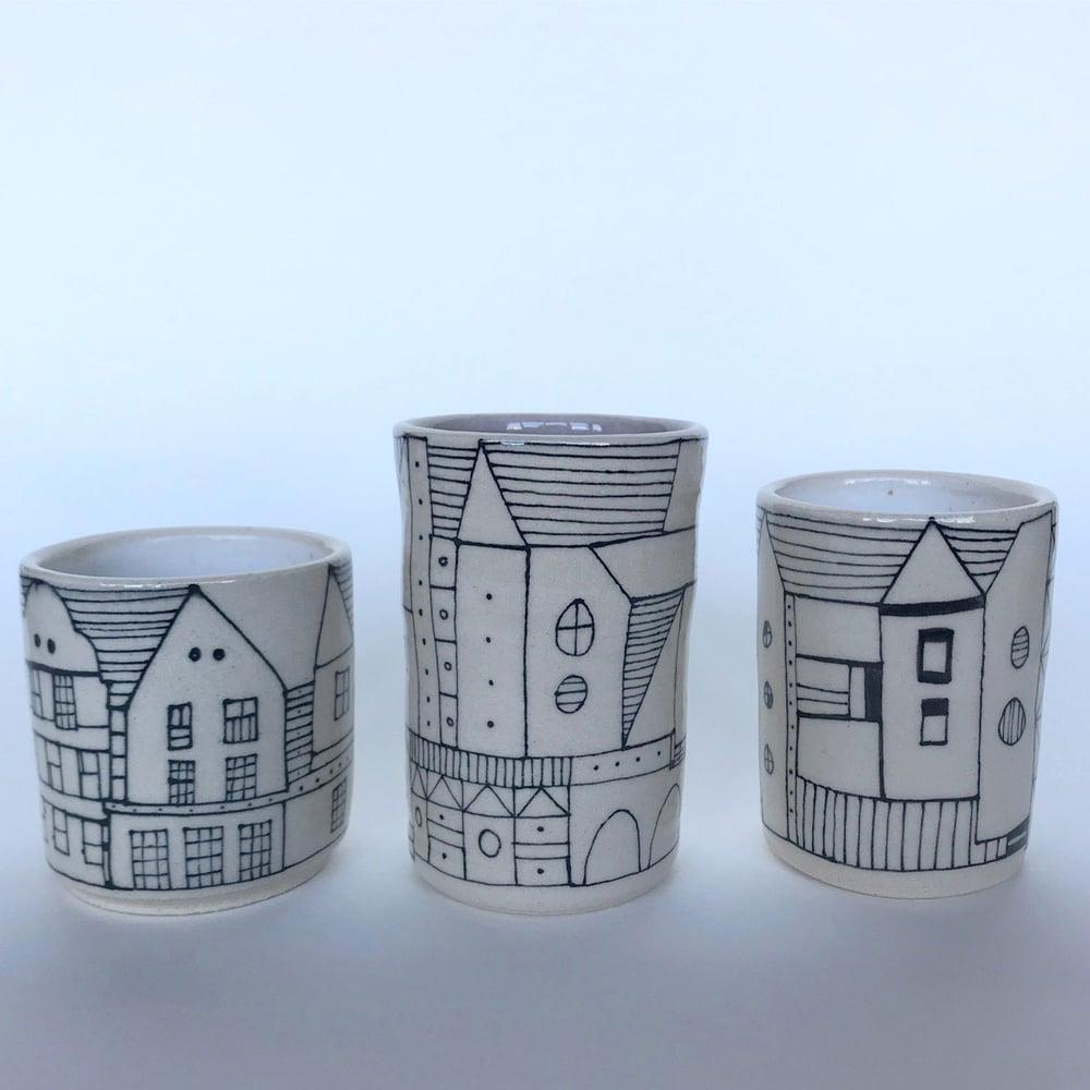 Image of Illustrated stoneware pots various sizes