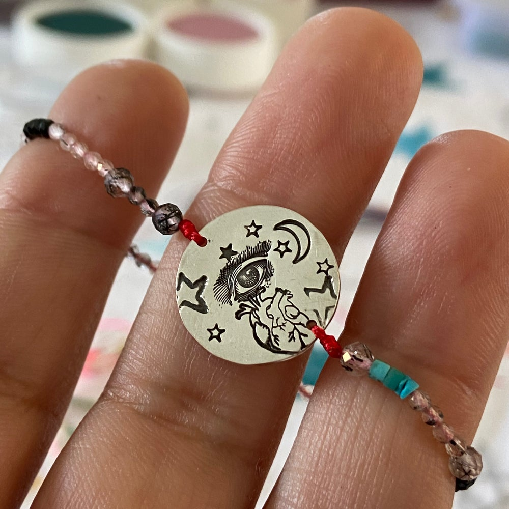 Image of eye and heart bracelet