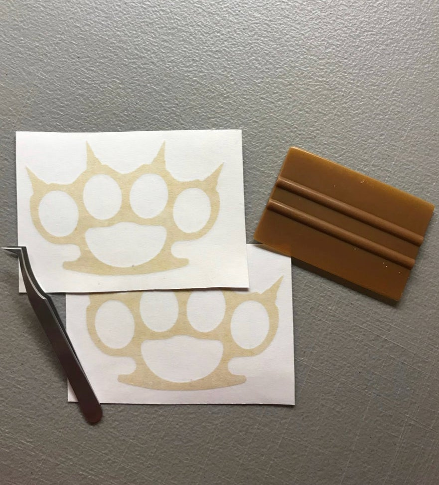 """Image of 10"""" brass knuckles decal"""