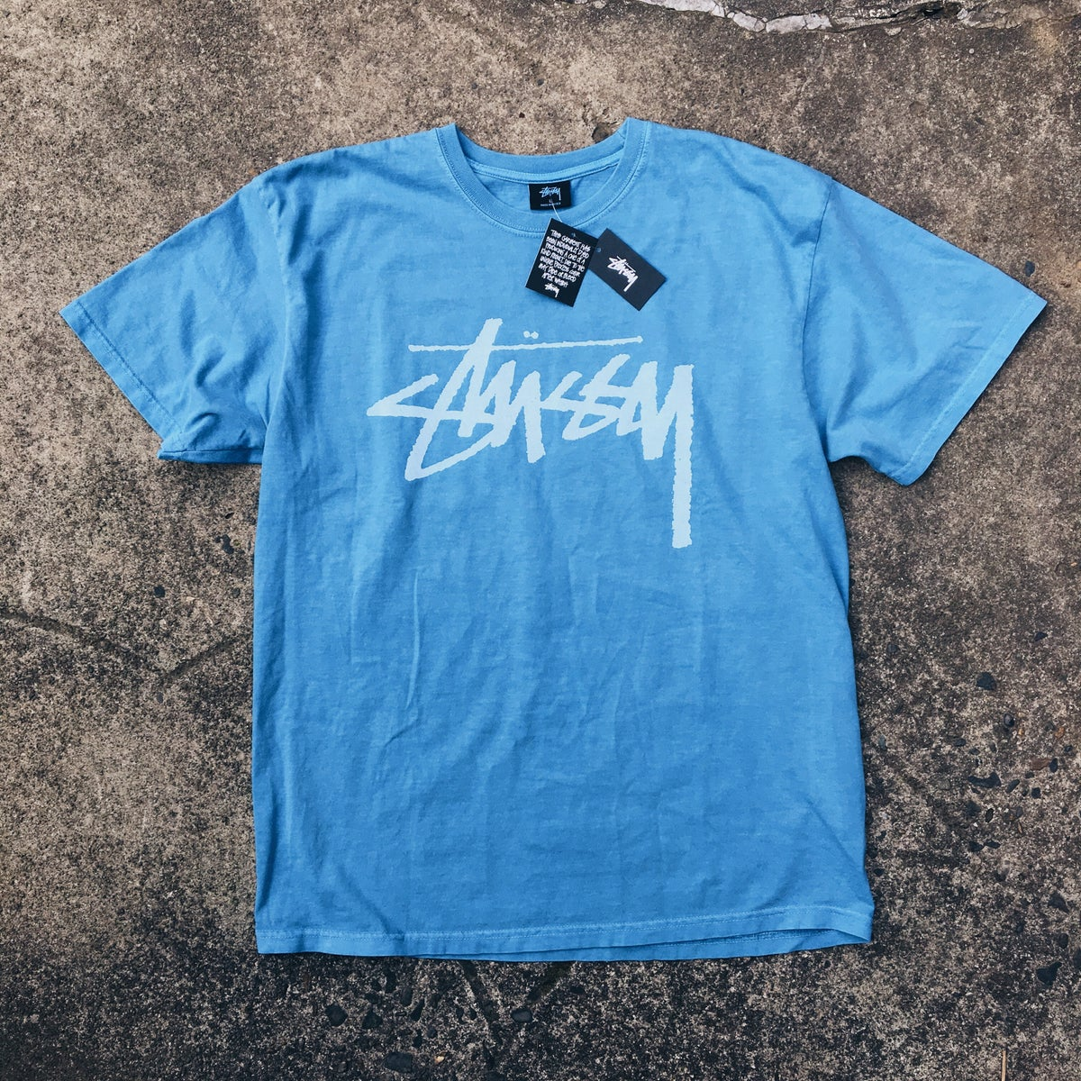 Image of Stussy Pigment Dye Spellout Tee.
