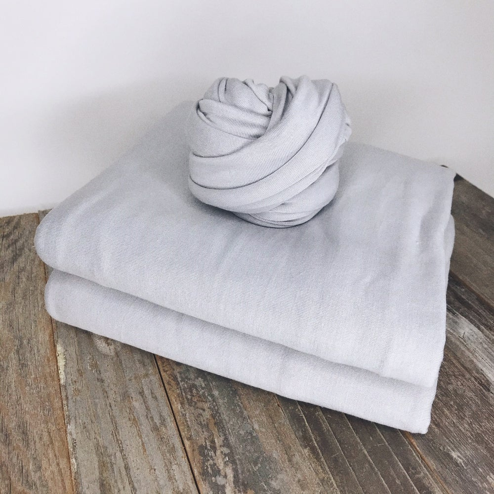 Image of Pale Grey/Silver Fabric starting at