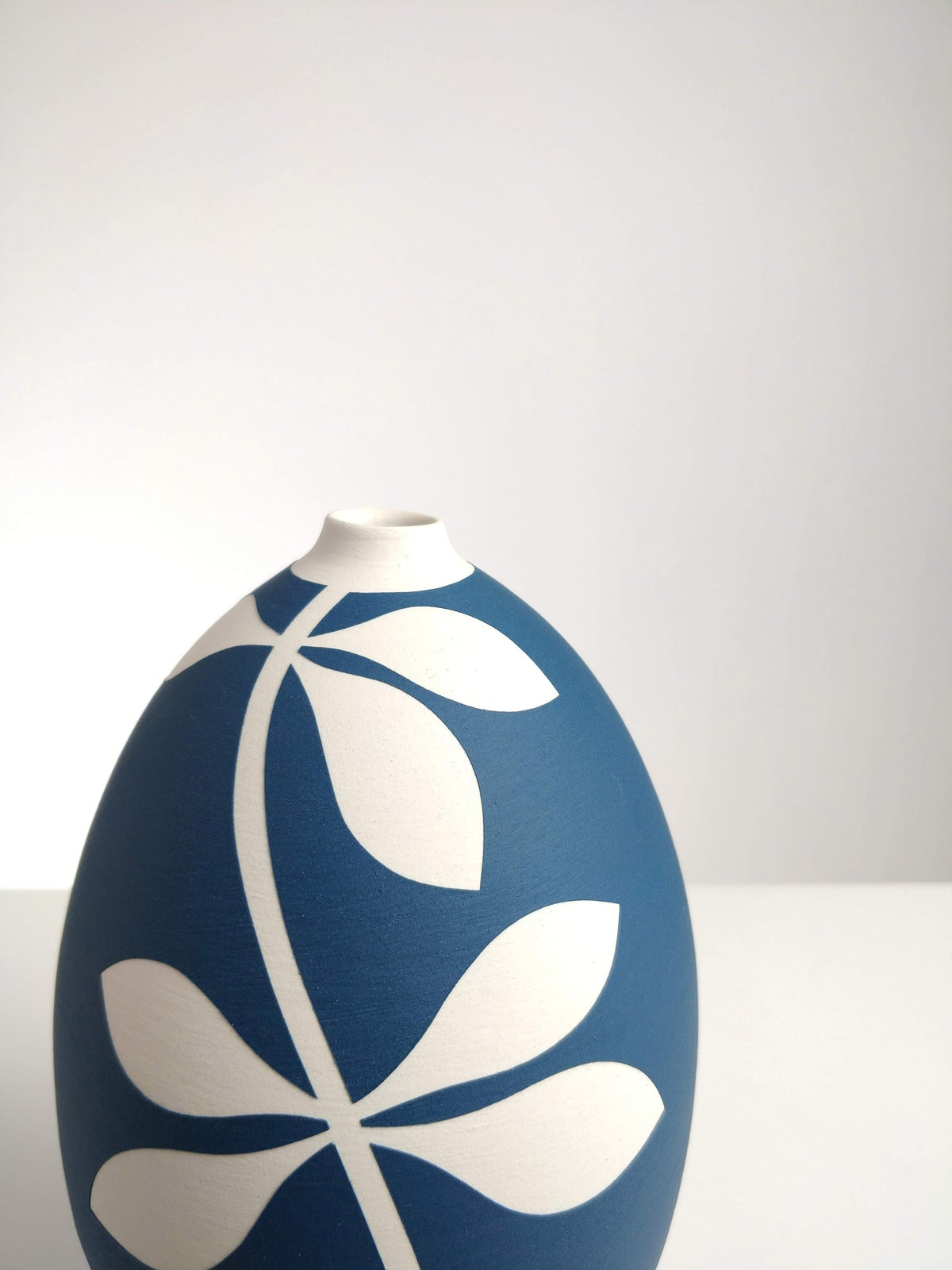Image of Small Sea Blue & White Leaf Vessel