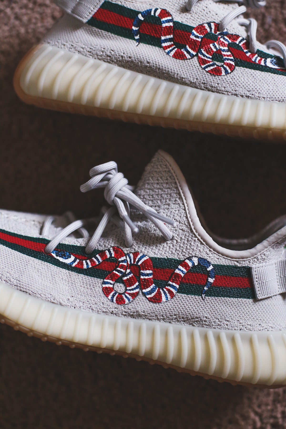 Image of Gucci snake with stripe