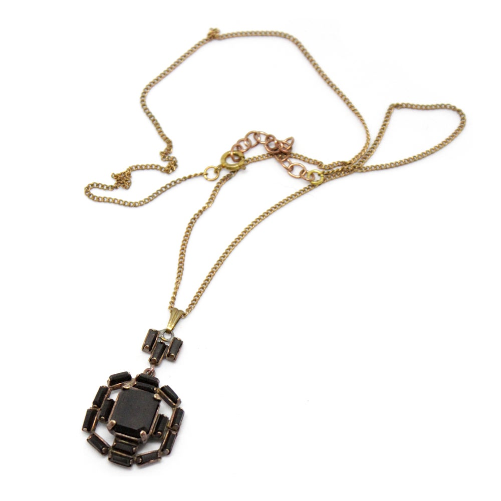 Image of VINTAGE BRASS CAST & EBONY NECKLACE