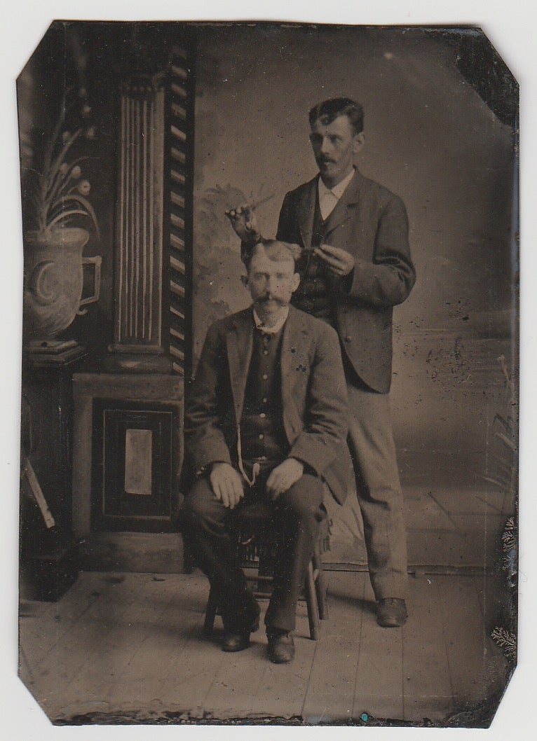 Image of Anonymous: barber with a client getting haircut, ca. 1870