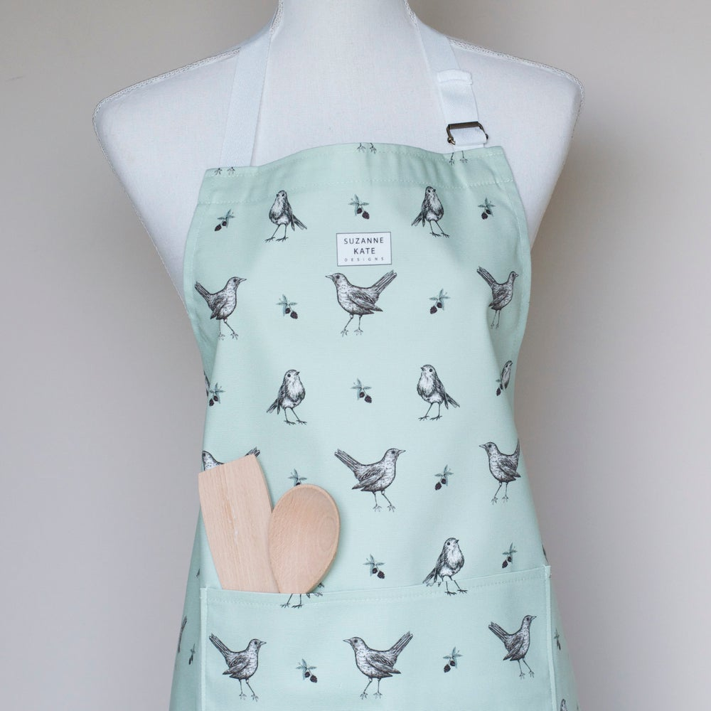 Image of Berry thieves apron in green