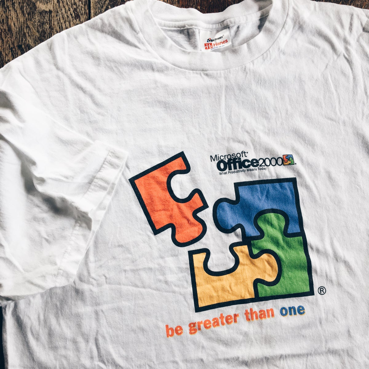 """Image of Original 1999 Microsoft Office """"Be Greater Than One"""" Tee."""