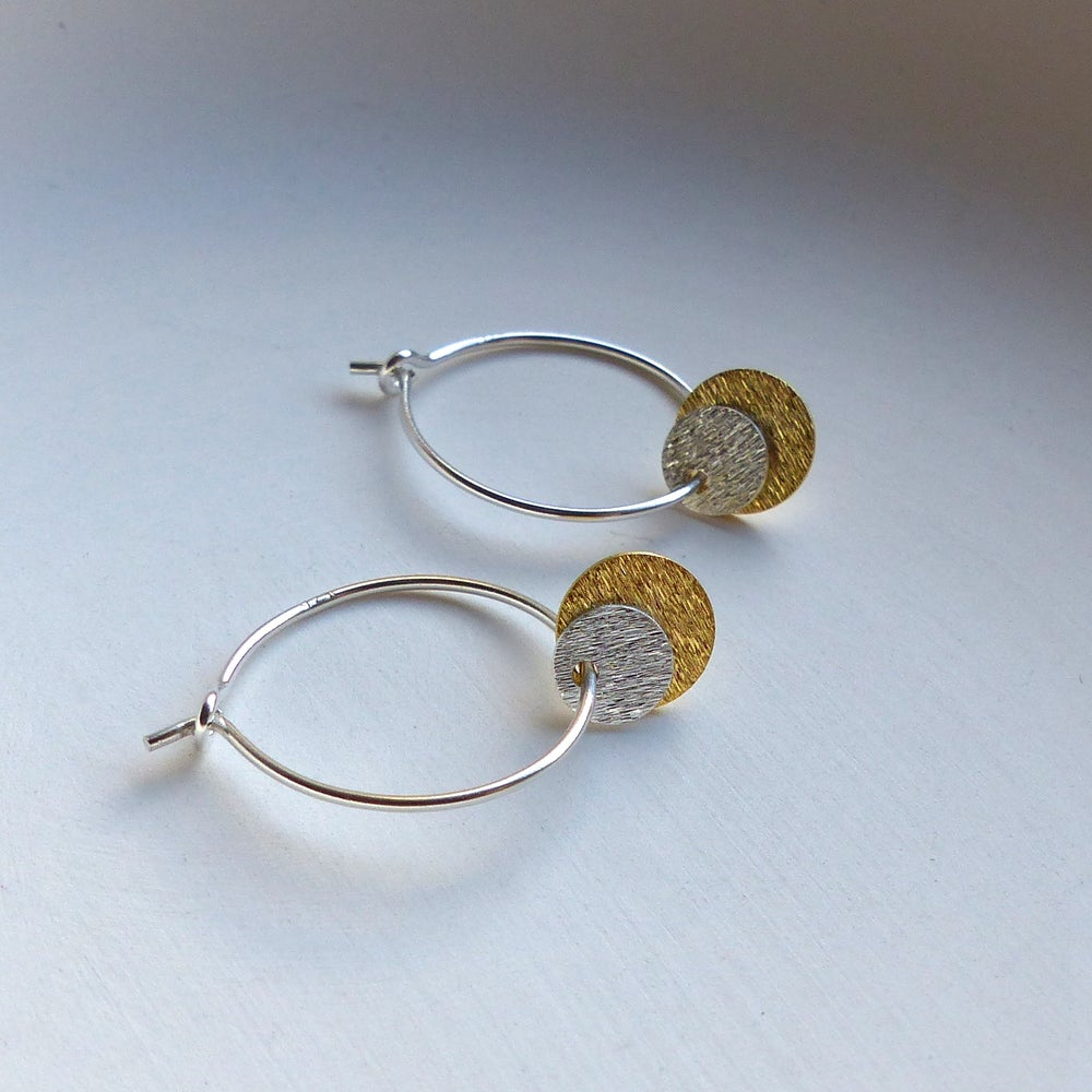 Image of Silver And Gold Double Disc Hoop Earrings