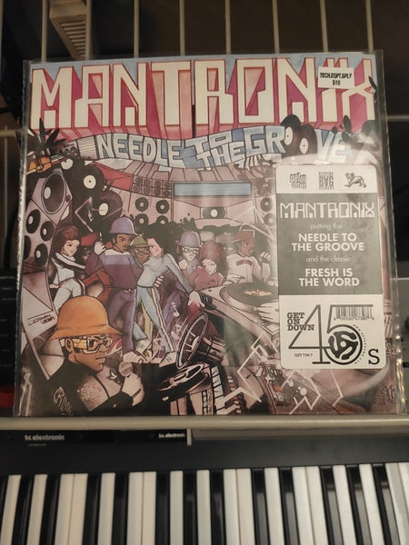Image of Mantronix ‎– Needle To The Groove / Fresh Is The Word
