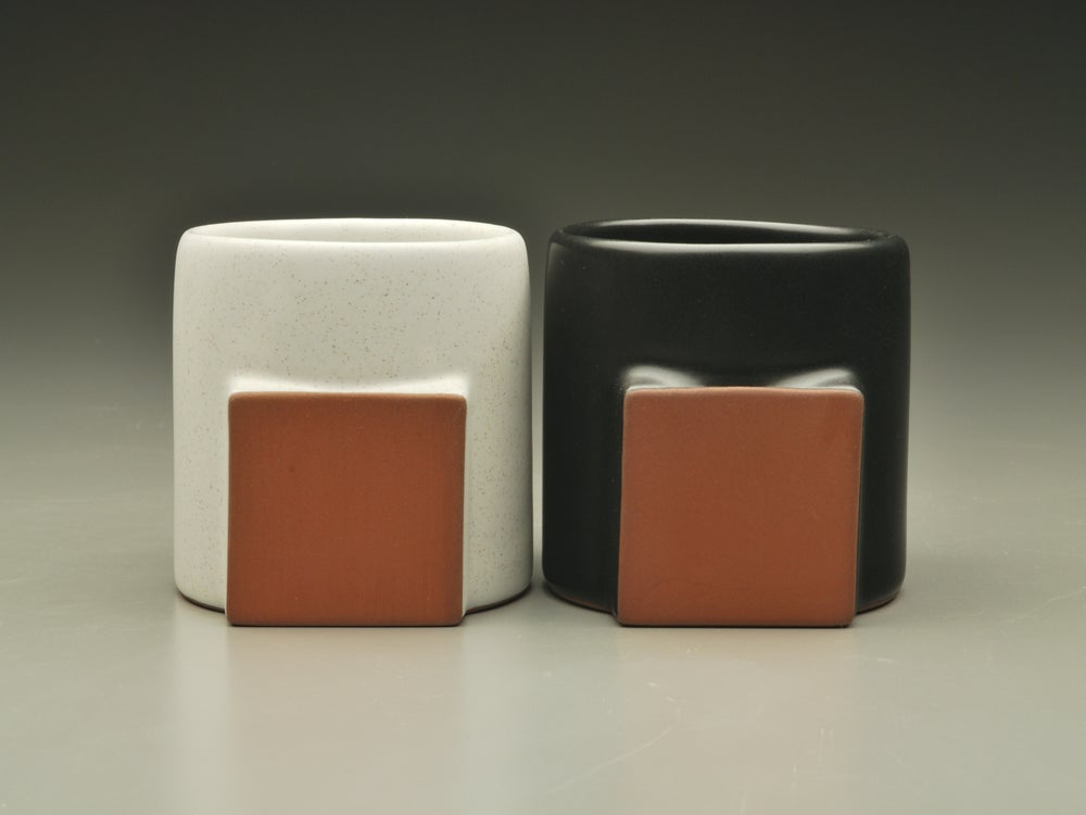 Image of White & Black Satin Glaze. These are Glaze Sample colors.