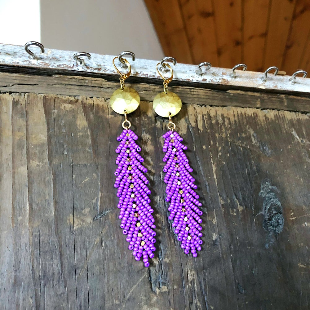 Image of Unnaturally purple feather earrings