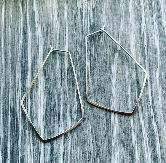 Image of Gently hammered, solid silver wire earrings.