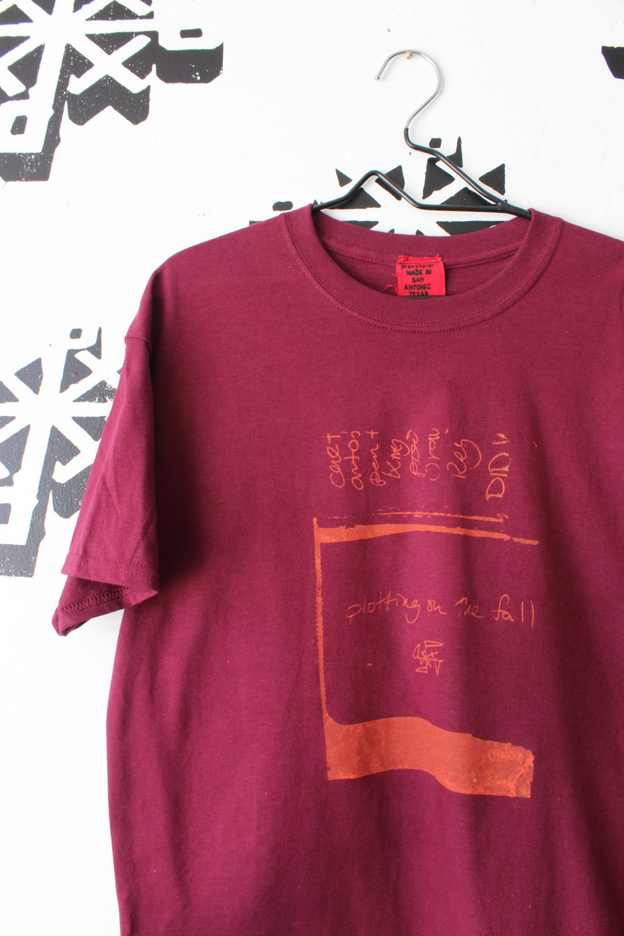 Image of plotting on the fall tee in maroon