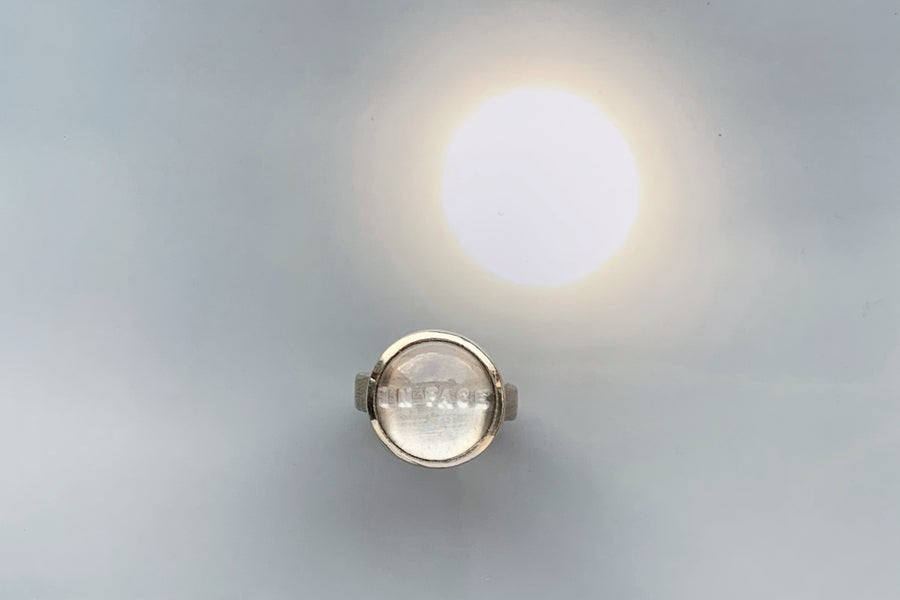 Image of silver ring with rock crystal IN PACE